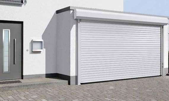 Puertas de garaje enrollables chipdigitalsl for Puertas automaticas garaje precios